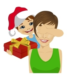 Son giving to mother christmas gift vector