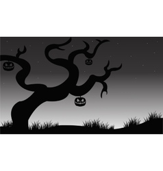 Halloween dry tree and pumkins vector