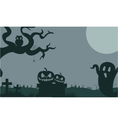 Halloween ghost and pumpkins in tomb at the night vector