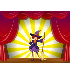 A witch at the stage with a red curtain vector