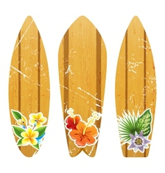 Wooden surfboards with floral prints vector