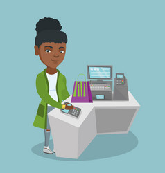 African woman paying wireless with a smart watch vector