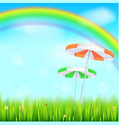 Summer background big bright rainbow above green vector