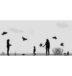 Family in the Park Feeding the Birds vector image