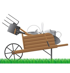 Garden wheelbarrow with tool vector