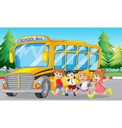 Students and school bus on the road vector image