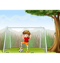 A young football player near the big tree vector image vector image