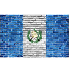 Flag of guatemala on a brick wall vector