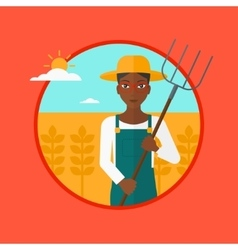 Farmer with pitchfork in wheat field vector