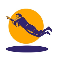 rugby player diving to score a try vector image