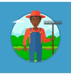 Farmer with rake at cabbage field vector