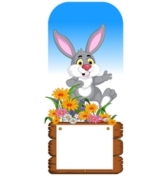 funny rabbit cartoon posing with blank board vector image