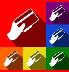 Hand holding a credit card set of icons vector