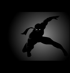 silhouette of a masked superhero vector image vector image