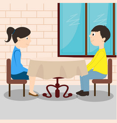 Young romantic couple sitting at the table vector
