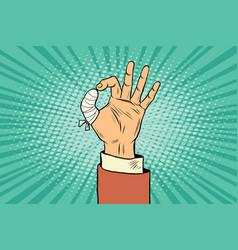 ok gesture bandaged finger vector image vector image