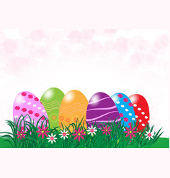Easter eggs in fresh green grass with copy space vector