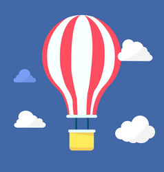Hot air balloon in the night sky with clouds vector