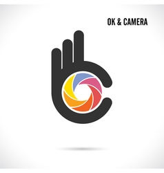 Creative hand and camera lens sign vector
