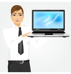 Career man holding laptop vector
