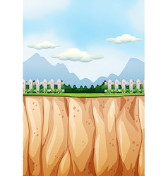 Scene with field and cliff vector