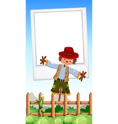 Frame design with scarecrow in field vector