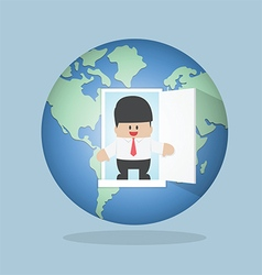Businessman open door from the world vector