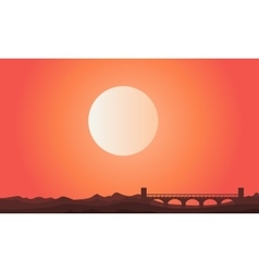 Silhouette of bridge with sun landscape vector