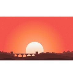 Silhouette of bridge landscape on orange sky vector