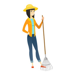 young asian farmer holding gardening rake vector image
