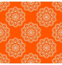 Seamless mandala pattern over orange vector