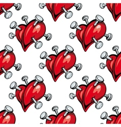 Seamless pattern of hearts studded with nails vector