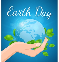 Planet earth and green leaves in hand vector