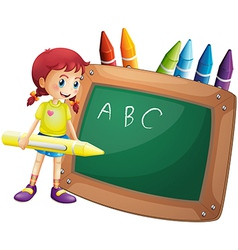 A girl holding a big crayon standing in front of a vector image