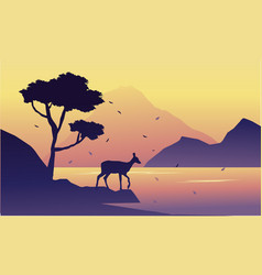 silhouette of deer on riverbank landscape vector image