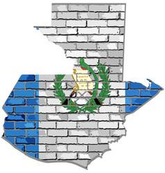 Guatemala map on a brick wall vector