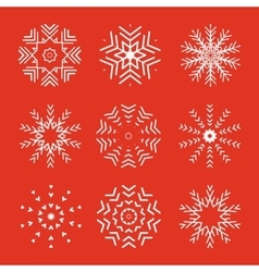 Set of 9 abstract snowflakes vector image