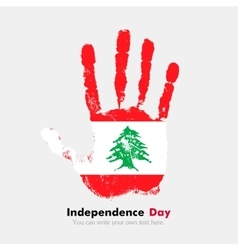 Handprint with the flag of lebanon in grunge style vector
