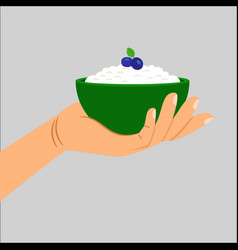 Hand holding cottage cheese with berry vector