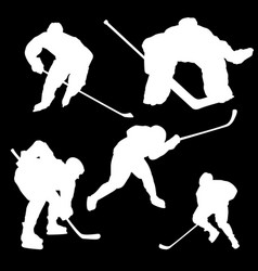 White silhouettes of hockey players on a black vector