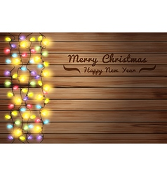 Christmas lights on wooden background vector image vector image