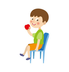 Flat boy sitting at chair eating apple vector