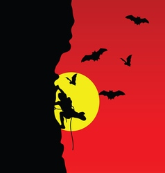 man on cliff with bat vector image