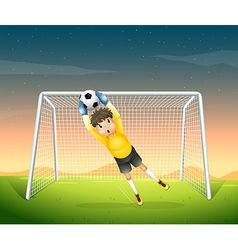 A young football player in his yellow uniform vector image vector image