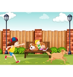 Girls playing with dogs in park vector