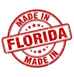 Made in florida red grunge round stamp vector