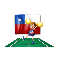 A cheerleader dancing in front of the Chile flag vector image