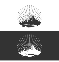 Silhouette of the mountains and sunburst vector