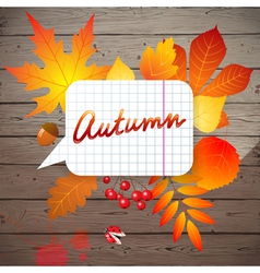 Wooden background with autumn leaves vector