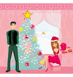 Girl surprising a boy with a gift in christmas vector
